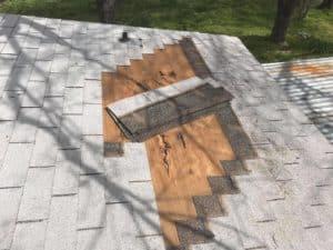 Missing or broken roof shingle